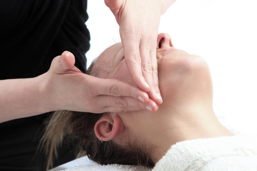 A photograph showing Japanese Facelift Massage by Dr Katerina Steventon FaceWorkshops Clinic