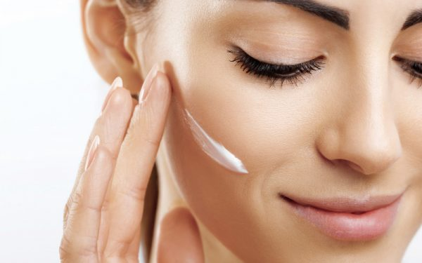 Young woman applying skin cream for What is new in skincare blog